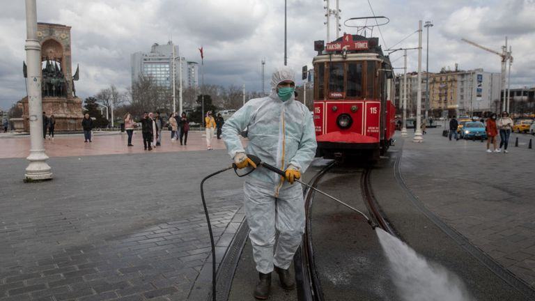 A worker disinfects areas of Istanbul's Taksim Square