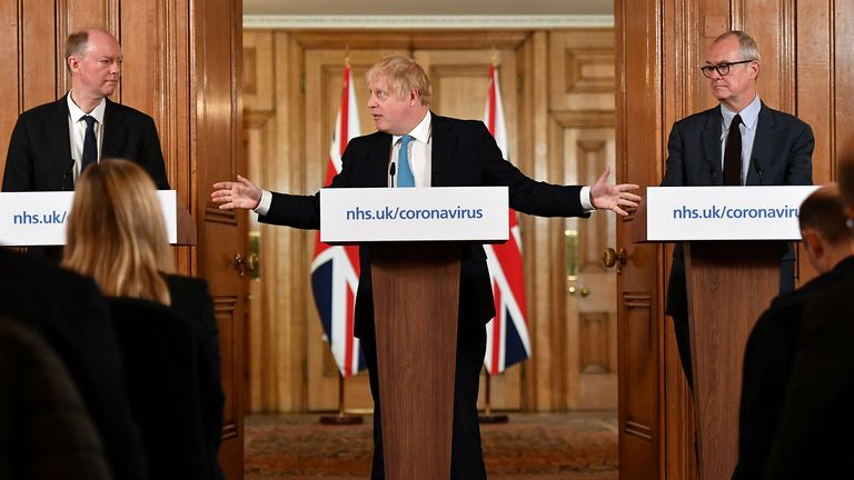 Britain's Chief Medical Officer Professor Chris Whitty (L) and Chief Scientific Adviser Patrick Vallance  look on as British Prime Minister Boris Johnson gestures as he speaks during a coronavirus disease (COVID-19) news conference inside 10 Downing Street, London, Britain March 19, 2020.  Leon Neal/Pool via REUTERS
