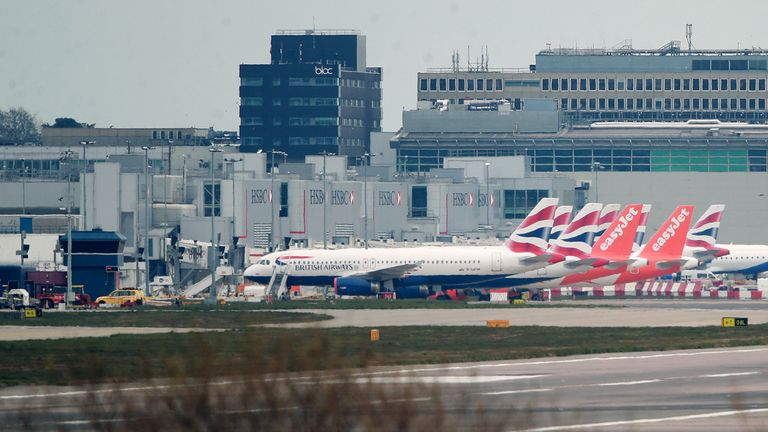 British Airways and easyJet planes are seen parked at Gatwick Airport in Crawley, West Sussex, after easyJet announced it has grounded its entire fleet of 344 aircraft due to the coronavirus pandemic.
