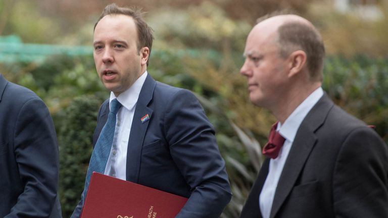 Health Secretary Matt Hancock (L) and chief medical officer Chris Whitty (right) arrive at Downing Street for the emergency Cobra meeting on coronavirus