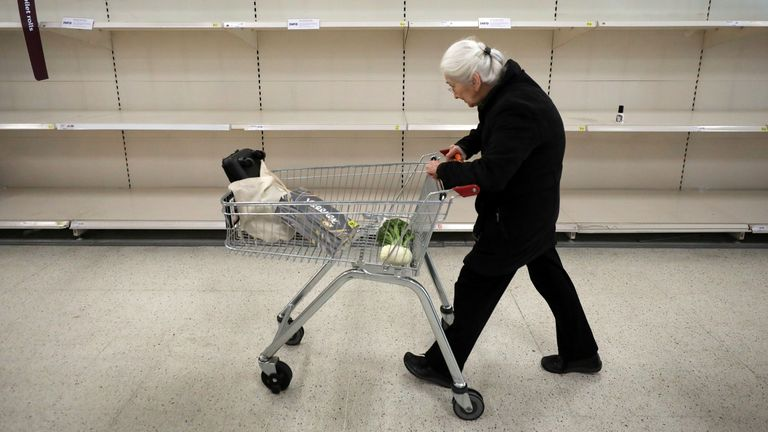 An elderly lady passes empty shelves in Sainsbury's supermarket as the coronavirus disease (COVID-19) outbreak continues, in Fulham, London, Britain March 18, 2020. REUTERS/Kevin Coombs