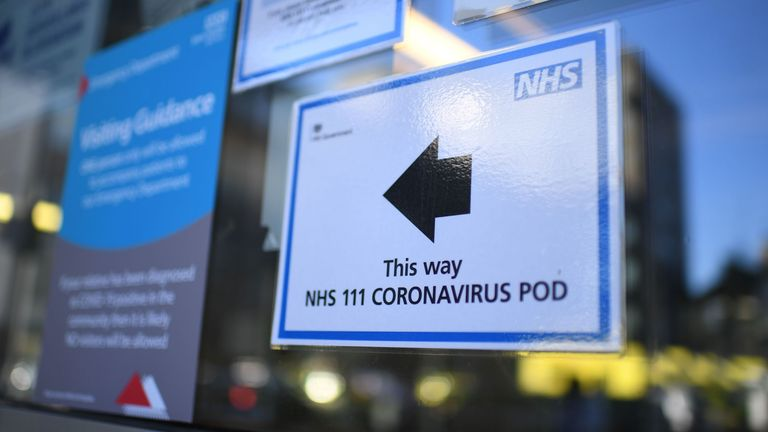 A sign points the way to a NHS 111 Coronavirus Pod at The Royal London Hospital in London on March 23, 2020. - Prime Minister Boris Johnson warned on Sunday he may impose tougher controls on the British public as packed parks, markets and cafes at the weekend showed thousands of people defying government warnings about social distancing. The PM gave notice of potential tougher action as the latest health department figures revealed that 281 people had now died from COVID-19 in the UK, an increas