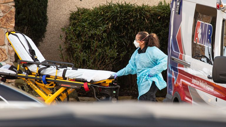 SEATTLE, WA - FEBRUARY 29: A healthcare worker prepares to transport a patient on a stretcher into an ambulance at Life Care Center of Kirkland on February 29, 2020 in Kirkland, Washington. Dozens of staff and residents at Life Care Center of Kirkland are reportedly exhibiting coronavirus-like symptoms, with two confirmed cases of (COVID-19) associated with the nursing facility reported so far. (Photo by David Ryder/Getty Images)