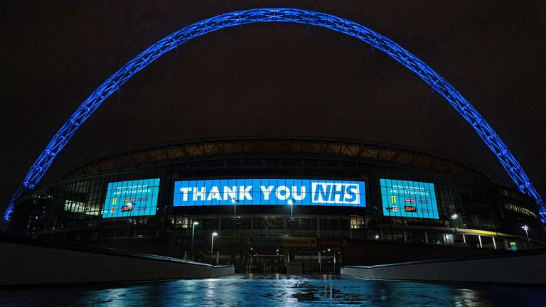 The Wembley Stadium arch lit up in blue to support for the NHS during the current Corona Virus crisis. Pic: Jed Leicester for The FA/Shutterstock