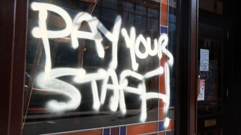 "Graffiti on a JD Wetherspoon pub in Crystal Palace, south London. Wetherspoons workers have described founder Tim Martin's lack of support for his chain's 40,000 employees as ""absolutely outrageous"". PA Photo. Picture date: Wednesday March 25, 2020. See PA story HEALTH Coronavirus Wetherspoons Workers. Photo credit should read: Adam Davy/PA Wire"