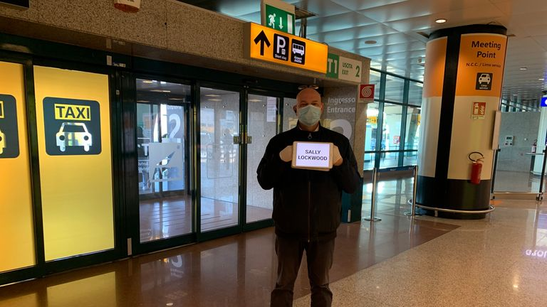 Taxi driver in Rome waiting Sally Lockwood at the airport after Italian government put the country into lockdown to stem the spread of COVID-19.