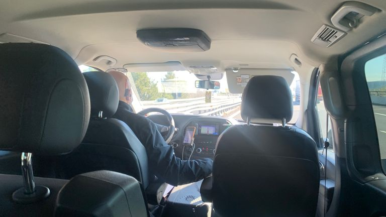 Taxi driver in Rome driving Sally Lockwood after Italian government put the country into lockdown to stem the spread of COVID-19.