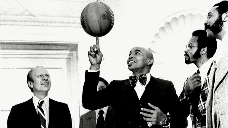 President Gerald Ford, enjoys a performance by Curly Neal and The Harlem Globetrotters, when they visited The White House, December 6, 1974. Pic: Everett/Shutterstock .