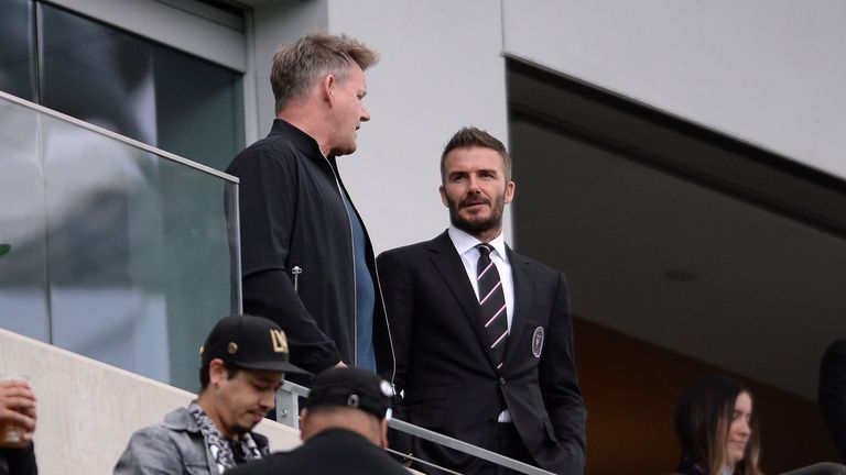 Inter Miami CF president David Beckham (R) and chef Gordon Ramsay (L) talk in a suite before the game