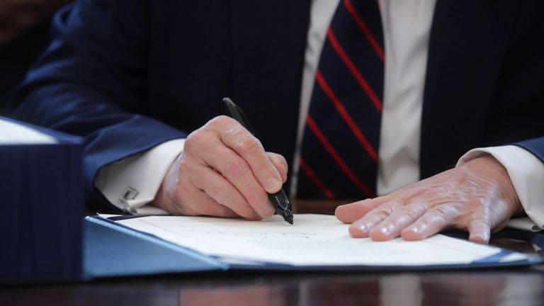 Mr Trump signed the bill in the Oval Office
