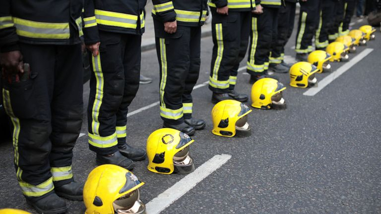Firefighters on the one year anniversary of the Grenfell Tower fire on June 14, 2018 in London, England