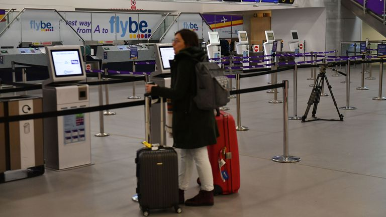 A passenger looks at empty check-in desks at Birmingham International Airport as Flybe, Europe's biggest regional airline, has collapsed into administration. PA Photo. Picture date: Thursday March 5, 2020. See PA story AIR FlyBe. Photo credit should read: Jacob King/PA Wire
