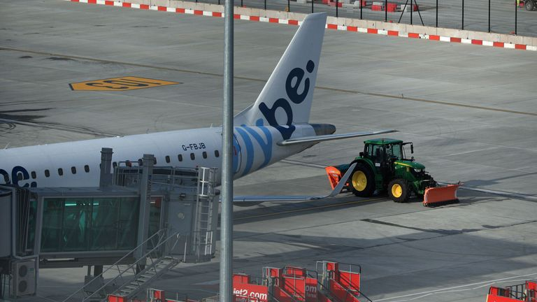 A tractor blocks the rear of a Flybe plane at Manchester Airport as Flybe, Europe's biggest regional airline, has collapsed into administration. PA Photo. Picture date: Thursday March 5, 2020. See PA story AIR FlyBe. Photo credit should read: Peter Byrne/PA Wire