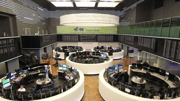 Just a handful of brokers are working inside the German Stock Exchange in Frankfurt as working from home takes hold
