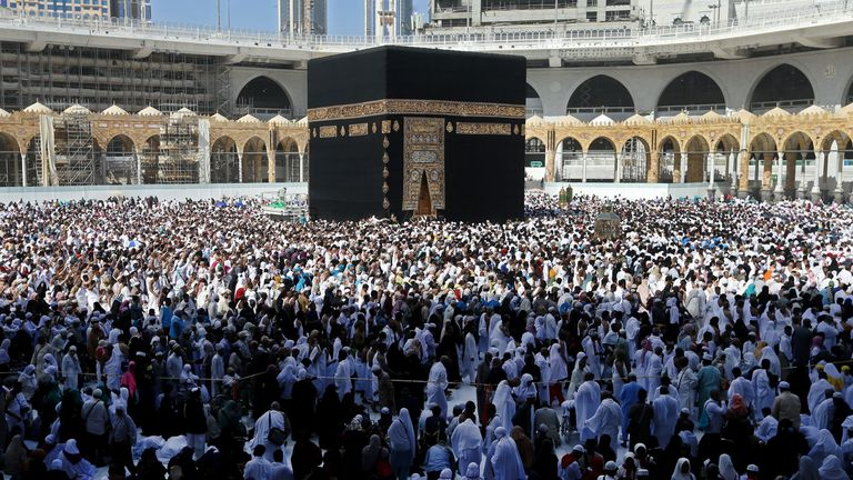 "Muslim pilgrims walk around the Kaaba (Tawaf al-Wadaa), Islam's holiest shrine, at the Grand Mosque in Saudi Arabia's holy city of Mecca on February 27, 2020. - Saudi Arabia suspended visas for visits to Islam's holiest sites for the ""umrah"" pilgrimage, an unprecedented move triggered by coronavirus fears that raises questions over the annual hajj. The kingdom, which hosts millions of pilgrims every year in the cities of Mecca and Medina, also suspended visas for tourists from countries with rep"