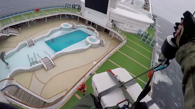 A helicopter delivers coronavirus test kits to the Grand Princess