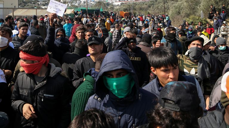Migrants take part in a demonstration, following clashes with riot police, on the island of Lesbos, Greece