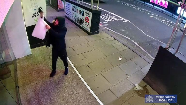CCTV captures a man spraying a foul-smelling liquid over the front of a family-run restaurant in Knightsbridge