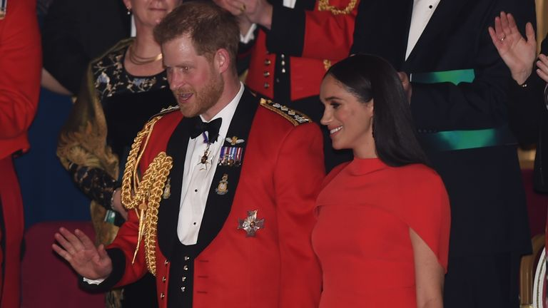 Harry and Meghan held hands as they were welcomed to the festival