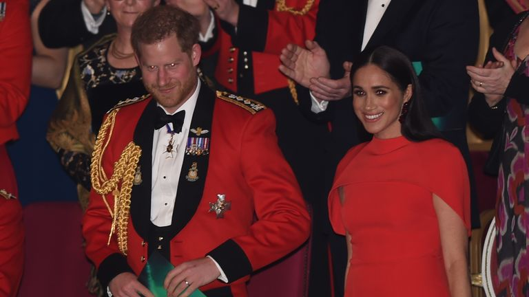 The duke and duchess received a standing ovation as they took their seats