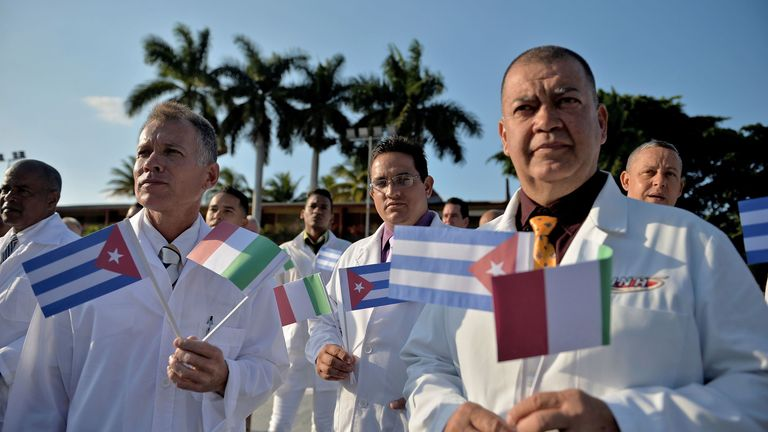 Doctors and nurses of Cuba's Henry Reeve International Medical Brigade are bid farewell before they travel to hard-hit Italy to help in the fight against the coronavirus COVID-19 pandemic, at the Central Unit of Medical Cooperation in Havana, on March 21, 2020