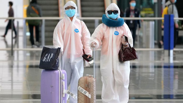 Some people arriving back in Hong Kong are taking no chances