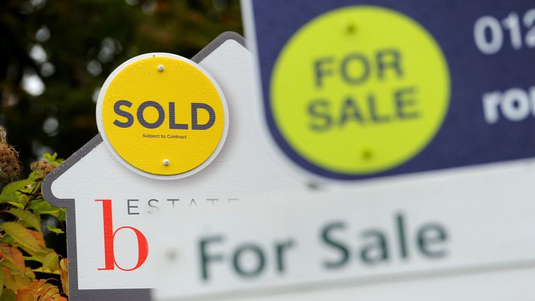 File photo dated 14/10/14 of estate agents signs.