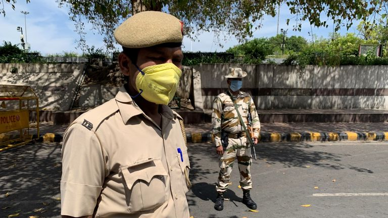 Security personnel are wearing masks but many poorer people have not been able to get hold of protective equipment