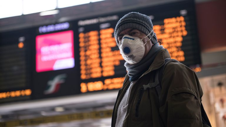 A man wears a mask at Porta Nuova station in Turin