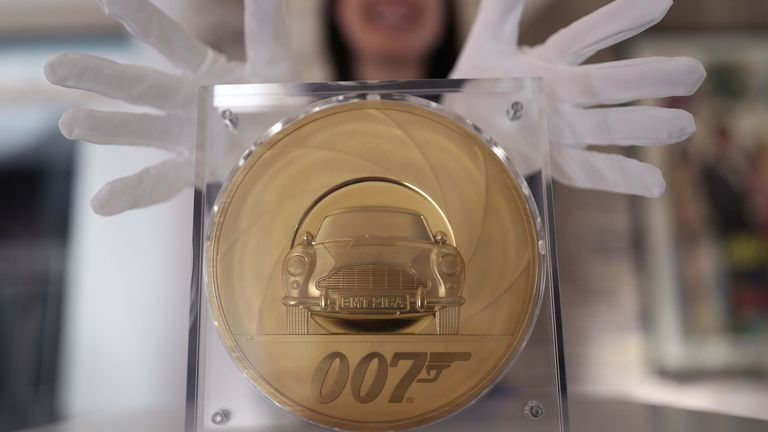 The special coin features an Aston Martin in the centre of a barrel of a gun. The famous 007 logo is featured underneath