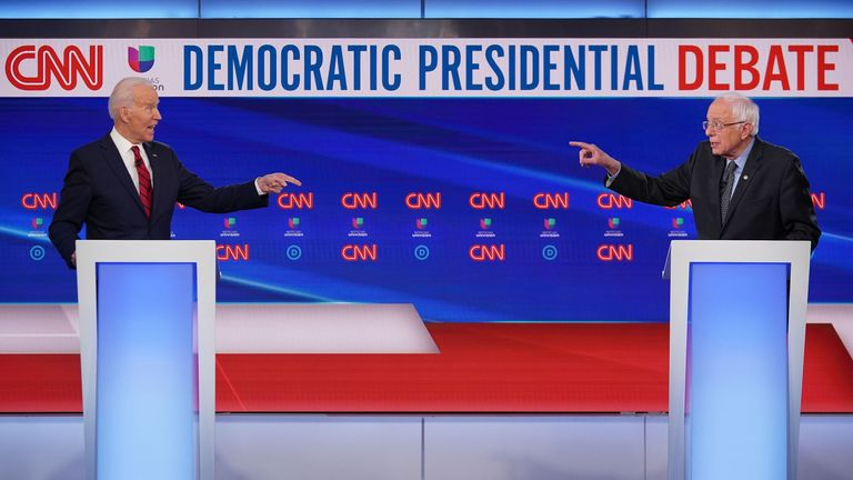 Democratic presidential hopefuls former US vice president Joe Biden (L) and Vermont Senator Bernie Sanders (R) take part in the 11th Democratic Party 2020 presidential debate in a CNN Washington Bureau studio in Washington, DC on March 15, 2020.