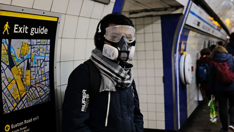 A person wearing a full face mask in King's Cross underground station in London after NHS England announced that the coronavirus death toll had reached 104 in the UK. PA Photo. Picture date: Wednesday March 18, 2020. See PA story HEALTH Coronavirus. Photo credit should read: Ian Hinchliffe/PA Wire