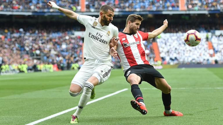 Karim Benzema of Real Madrid CF battles for the ball with Inigo Martinez of Athletic Club during the La Liga match between Real Madrid CF and Athletic Club at Estadio Santiago Bernabeu on April 21, 2019