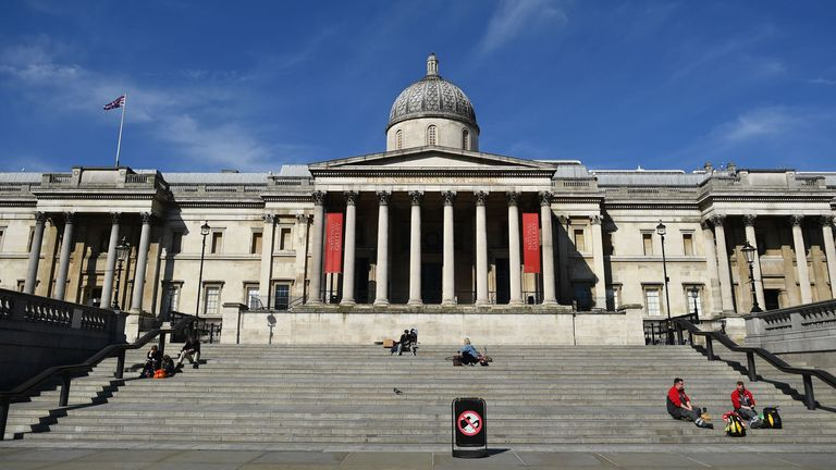 People sit on the steps of the National Gallery in Trafalgar Square