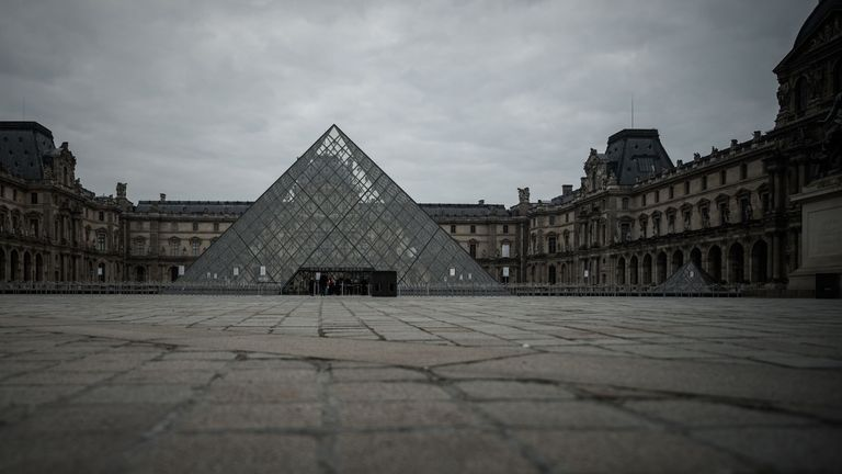 The empty square in front of the pyramid of the Louvre museum in Paris