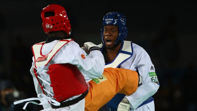 Lutalo Muhammad (R) of Great Britain competes against Cheick Sallah Cisse of Cote d'Ivoire in the Men's Taekwondo -80kg Gold Medal Contest on Day 14 of the Rio 2016 Olympic Games at Carioca Arena 3 on August 19, 2016 in Rio de Janeiro, Brazil