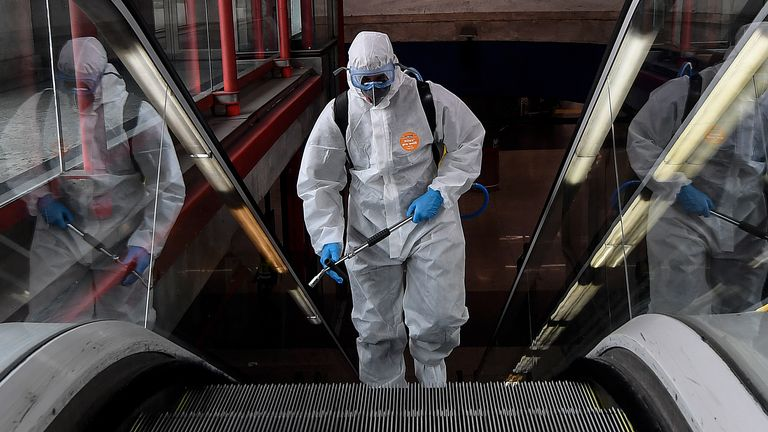 A member of the Military Emergencies Unit (UME) carries out a general disinfection at the Nuevos Ministerios Metro Station in Madrid