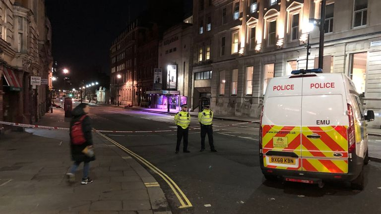 A police cordon in Westminster after a man brandishing knives was shot dead by police