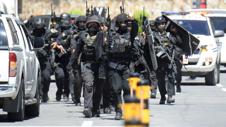A police SWAT team is inside the Manila shopping centre