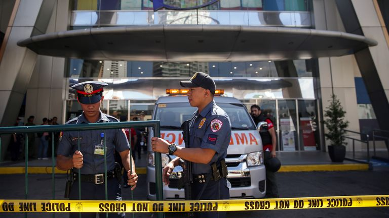 The area around the Greenhills shopping centre in Manila has been sealed off by police