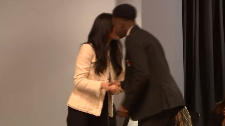 Head boy Aker Okoye appeared to give the duchess a peck on the cheek as he joined her on stage