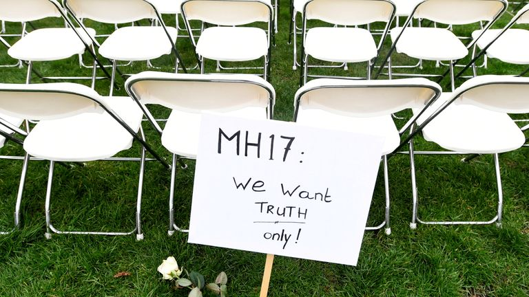 Family members of victims of the MH17 crash lined up empty chairs for each seat on the plane outside the Russian Embassy in The Hague
