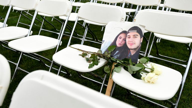 White roses were places on some of the chairs