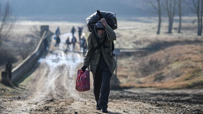 A migrant walks toward the Meritsa river near Edirne in northwest Turkey