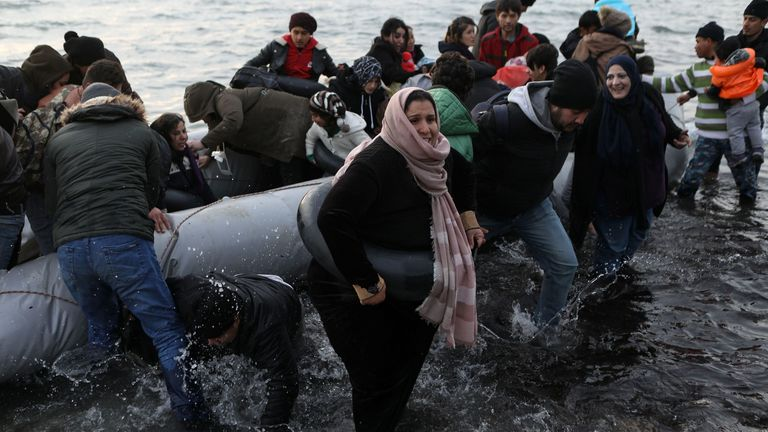Migrants from Syria, Iraq, Afghanistan and Palestinian territories arrive on a dinghy in Lesbos, Greece