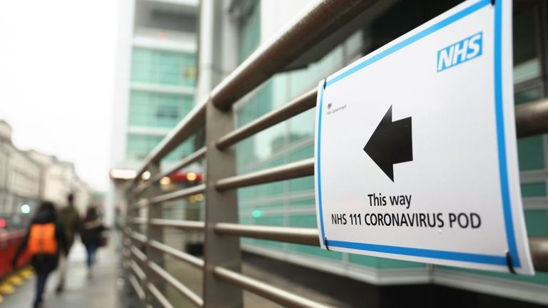 A sign directs directs patients to an NHS 111 Coronavirus Pod testing service area for COVID-19 assessment at University College Hospital in London on March 5, 2020. - The number of confirmed cases of novel coronavirus COVID-19 in the UK rose to 85 on March 4, with fears over the outbreak delaying the global release of the new James Bond movie and causing lack of demand for air travel that has proved the final nail in the coffin for British regional airline Flybe which went into administration o