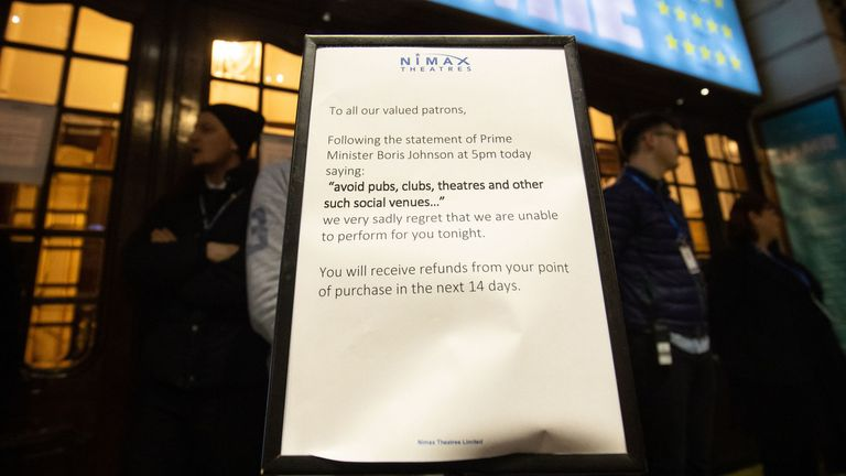 A notice outside London's Apollo Theatre tells patrons it has shut its doors