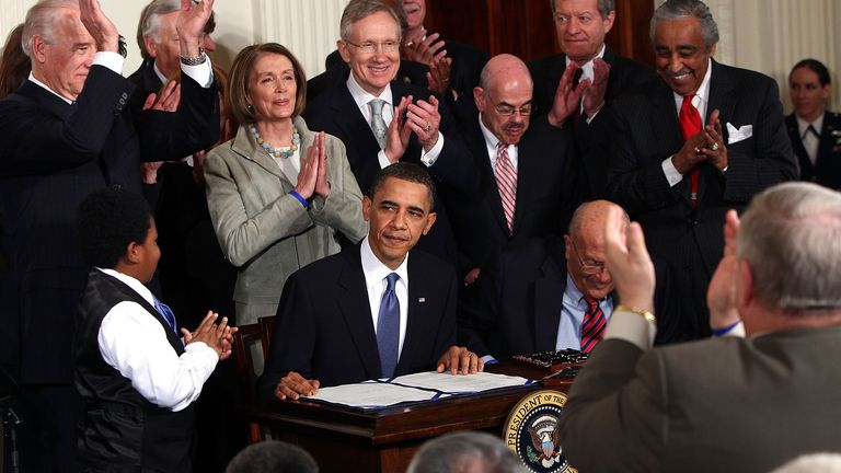 President Obama signs the Affordable Health Care for America Act in 2010