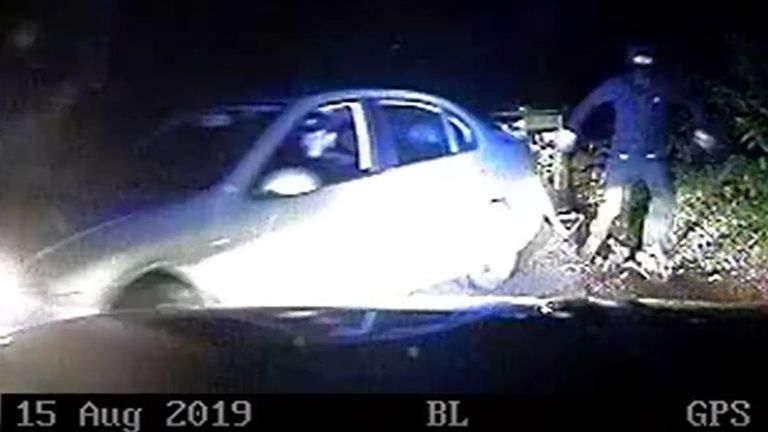 Screengrab taken from video dated 15/08/19 issued by Thames Valley Police of a man attempting to get into a Seat car after it was stopped by Pc Andrew Harper and Pc Andrew Shaw who were responding to a burglary in progress near Stanford Dingley in Berkshire. The dash-cam footage is taken from the vehicle in which PC Andrew Harper was travelling on the night of his death, which has been shown to the jury at the Old Bailey, London, during the trial of Henry Long and two teenagers who cannot be nam