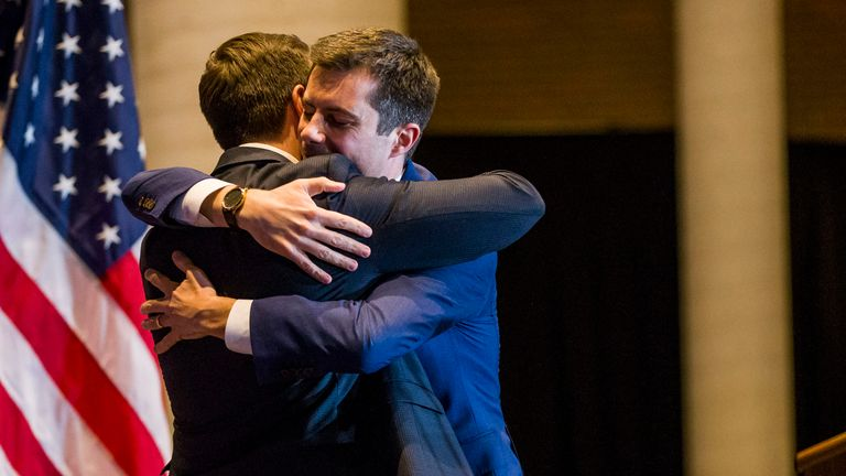 Former South Bend Mayor Pete Buttigieg, right, hugs his husband, Chasten Buttigieg, , before ending his presidential campaign